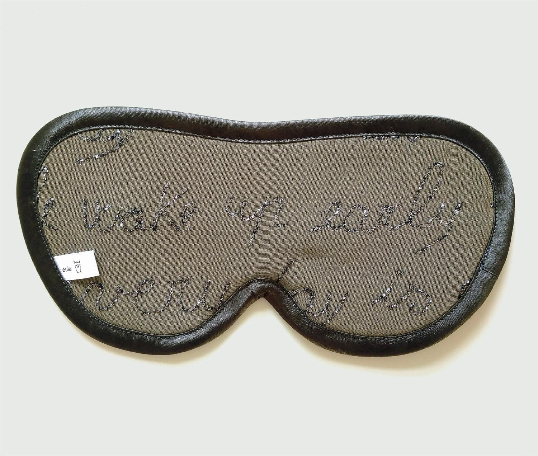 schlafbrille aus seide mit glitzerschrift