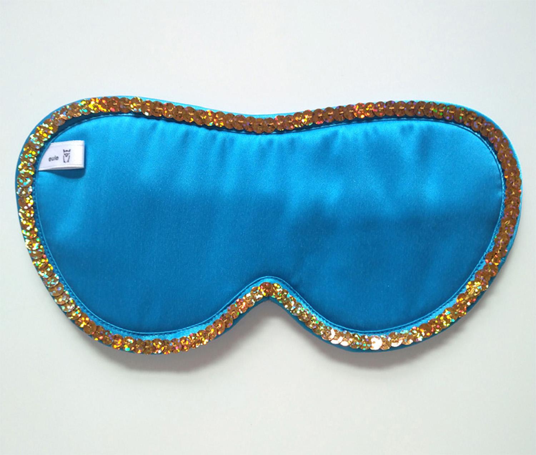 schlafbrille türkis mit goldenener paillettenumrandung